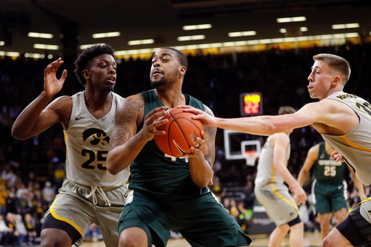 Michigan State forward Nick Ward drives to the basket against Iowa on Thursday night.