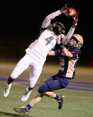 Khalil Dawsey makes a catch over Stoney Creek's Jack Warner in the fourth quarter of Groves' 28-6 win on September 7, 2018.