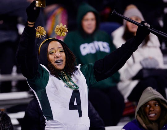 Chastity Pratt-Dawsey cheers for her son Khalil during the third quarter in their 25-6 win over Farmington Hills Harrison on October 12, 2018.  She always taught Khalil  that no dream is too big.