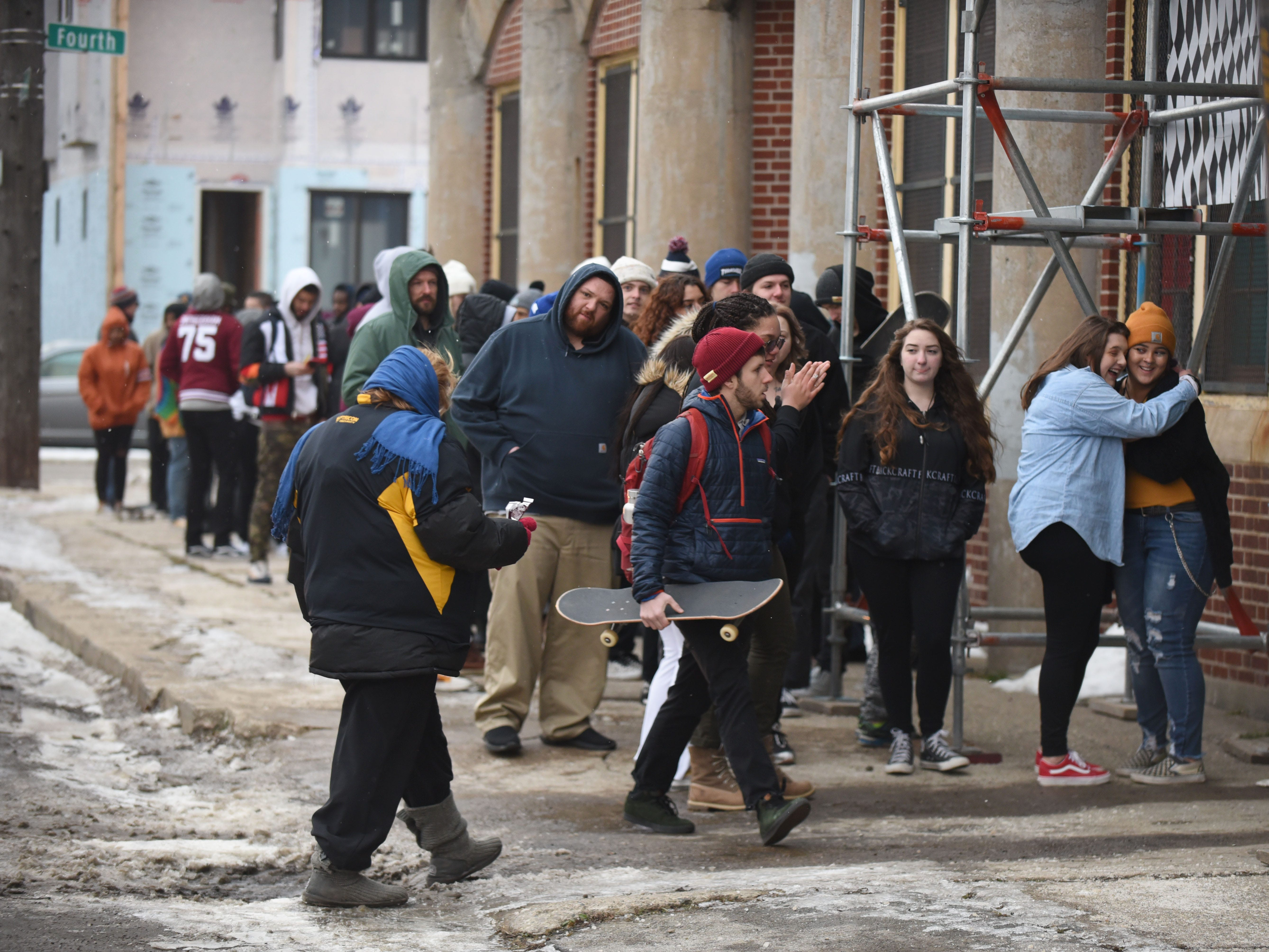 A large crowd waits outside the House of Vans pop-up event in Detroit on Thursday, Jan. 24, 2019.