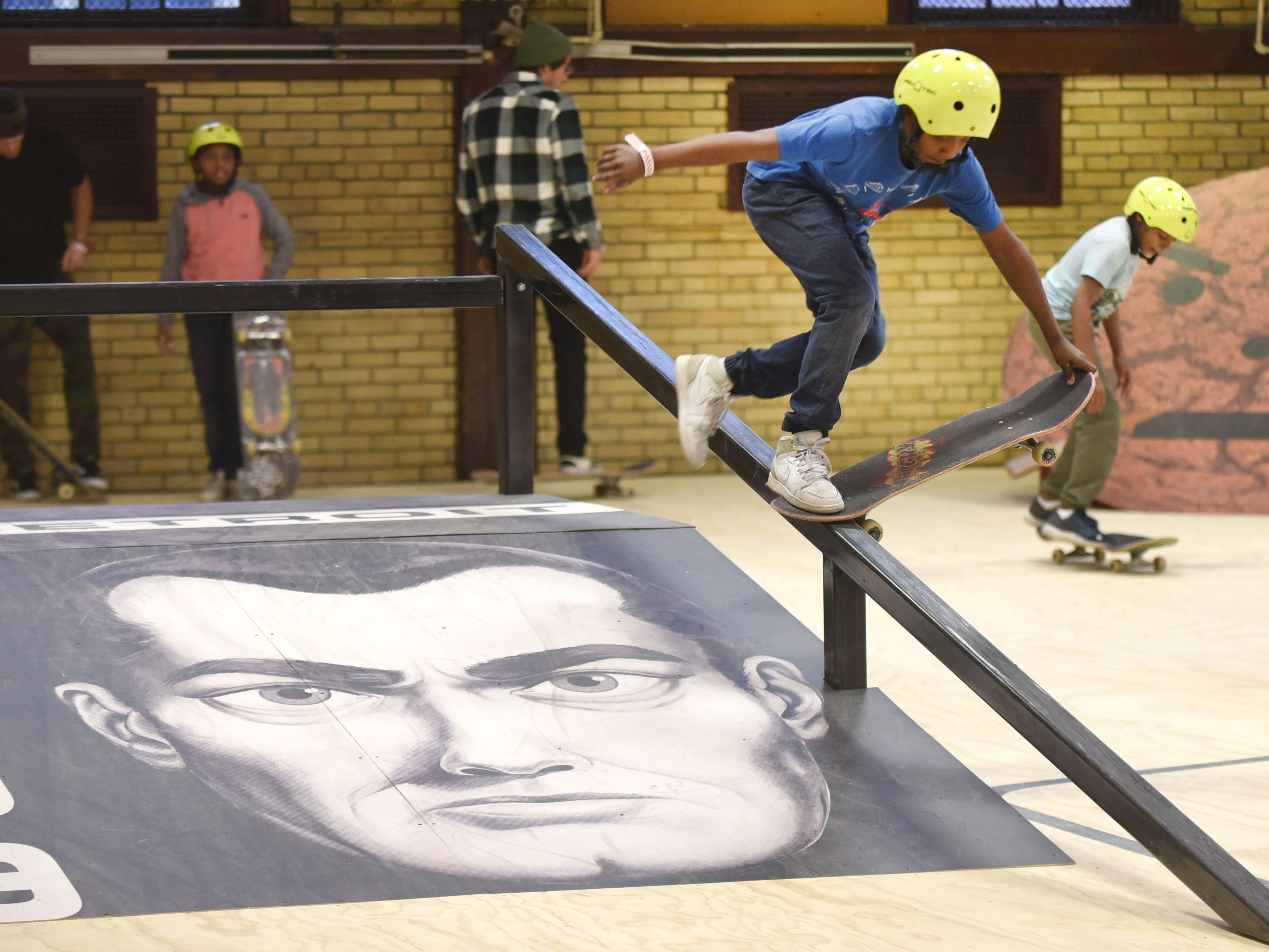 Rashad Wright of Detroit works a trick inside a custom skating rink with ramps at the House of Vans pop-up event.