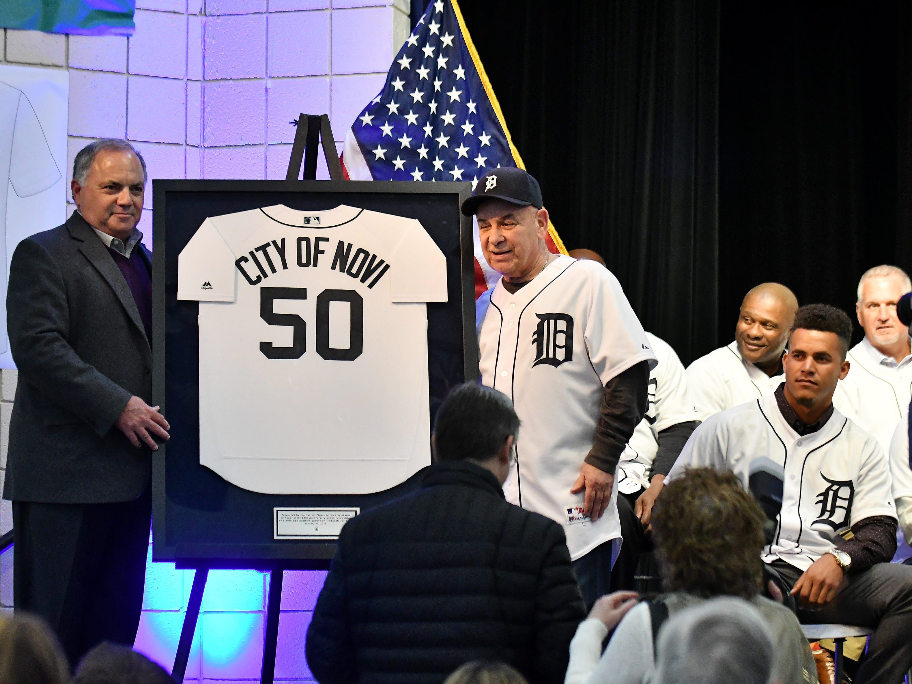 Tigers executive vice president of baseball operations and general manager Al Avila, left, and Novi mayor Bob Gatt with a jersey gift from the Tigers at the Novi Civic Center.