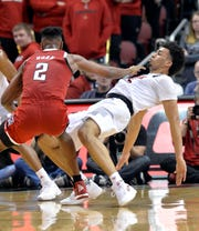 Louisville forward Jordan Nwora (33) takes a charge from North Carolina State guard Torin Dorn (2) during the second half.