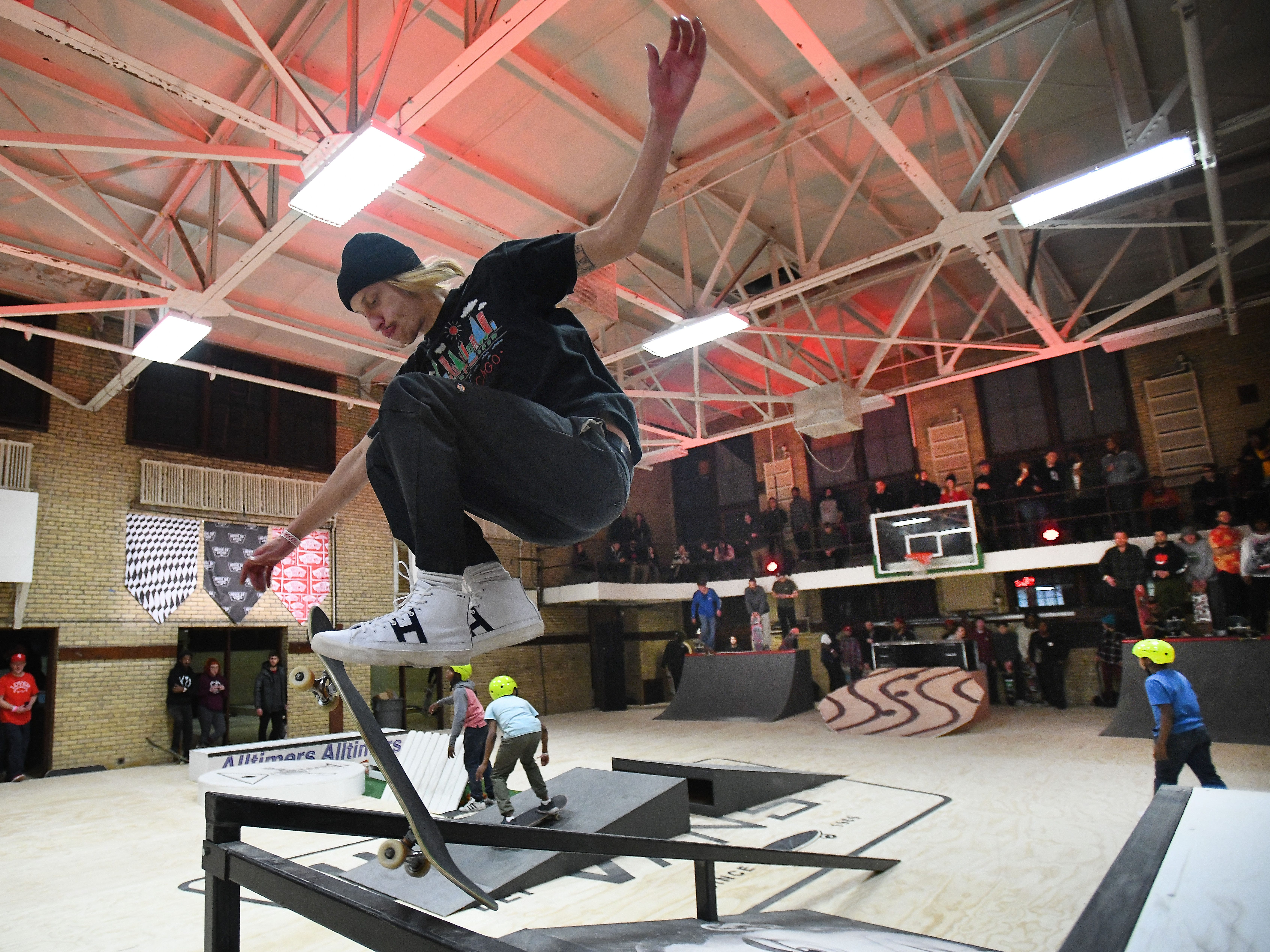 Jon Wiz of Detroit takes his board over the rail at a pop-up skate park.