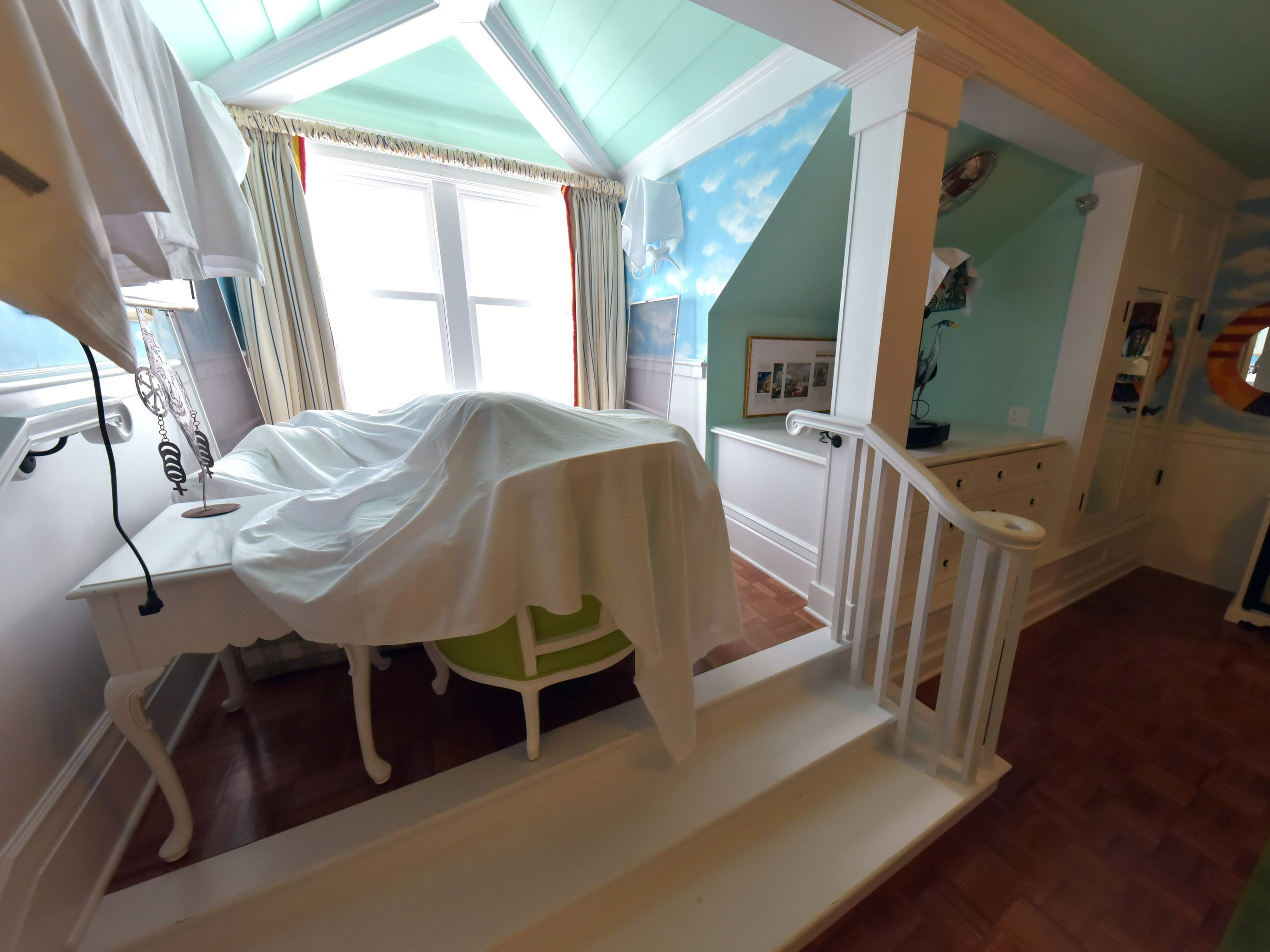 A completed parlor is shown with winter covers in Mackinac Island's iconic Grand Hotel.
