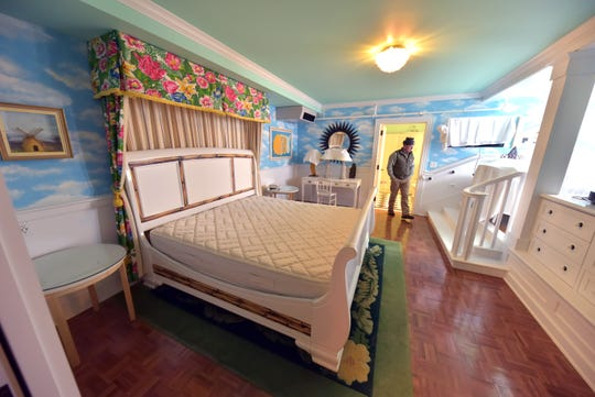 A bedroom in the Cupola Suites project at Mackinac Island's iconic Grand Hotel is inspected by Andy McGreevy, construction project manager.