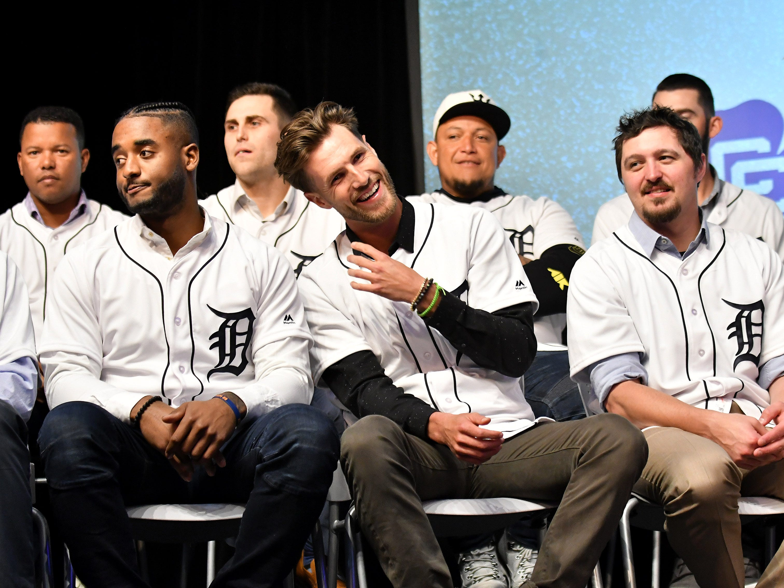 Tigers pitcher Shane Greene, center, laughs between his teammates, Niko Goodrum, left, and Blaine Hardy, right, at the Novi Civic Center.