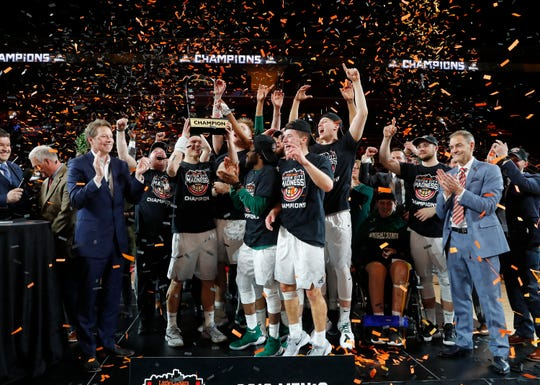 Wright State players celebrate their win against Cleveland State in the championship game of the 2018 Horizon League tournament in Detroit.
