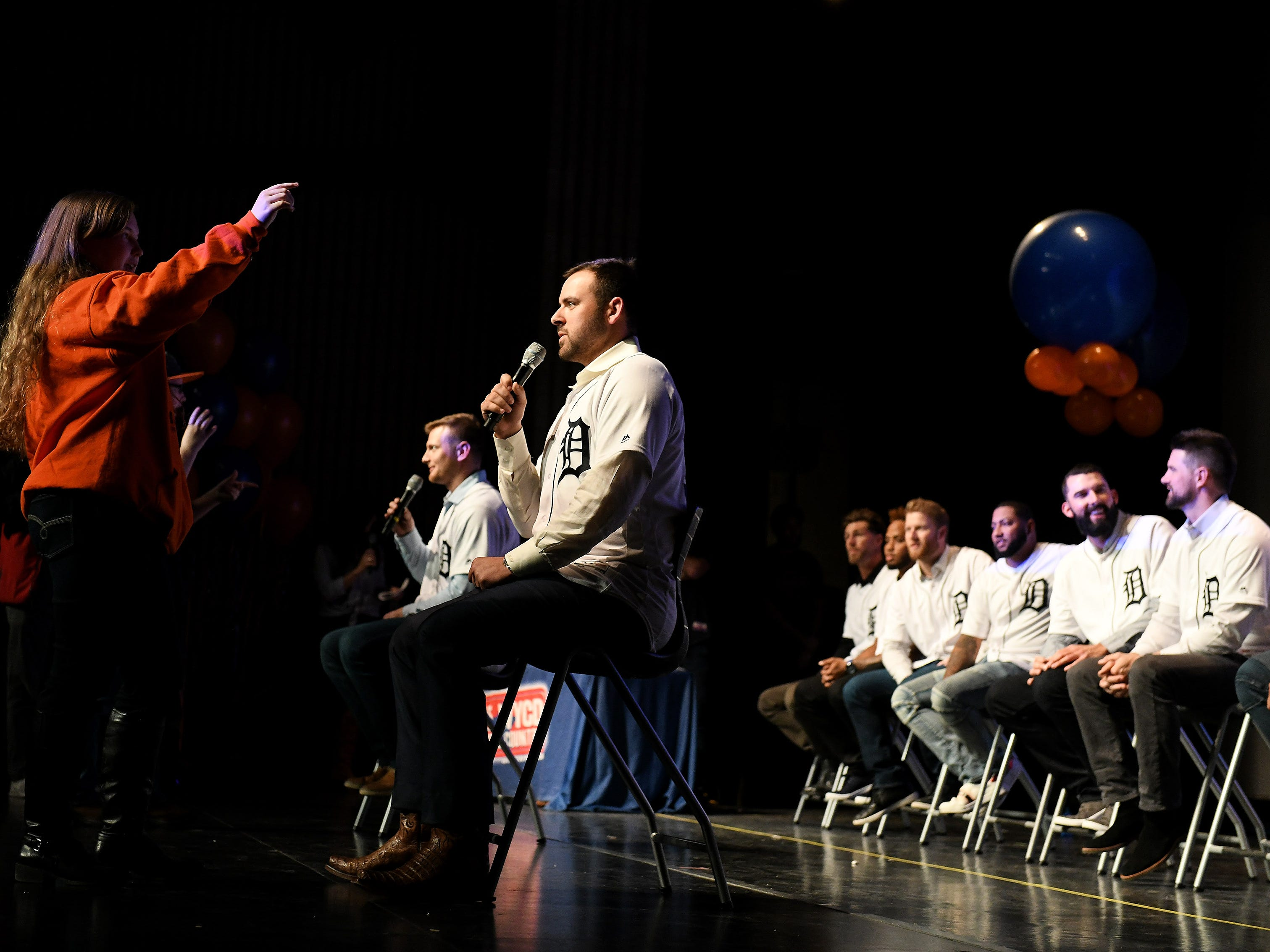 Lorna Davis, 15, of Carelton, left, gives clues to Tigers pitcher Michael Fulmer while they play a charades type game at a kids rally at Novi High School.
