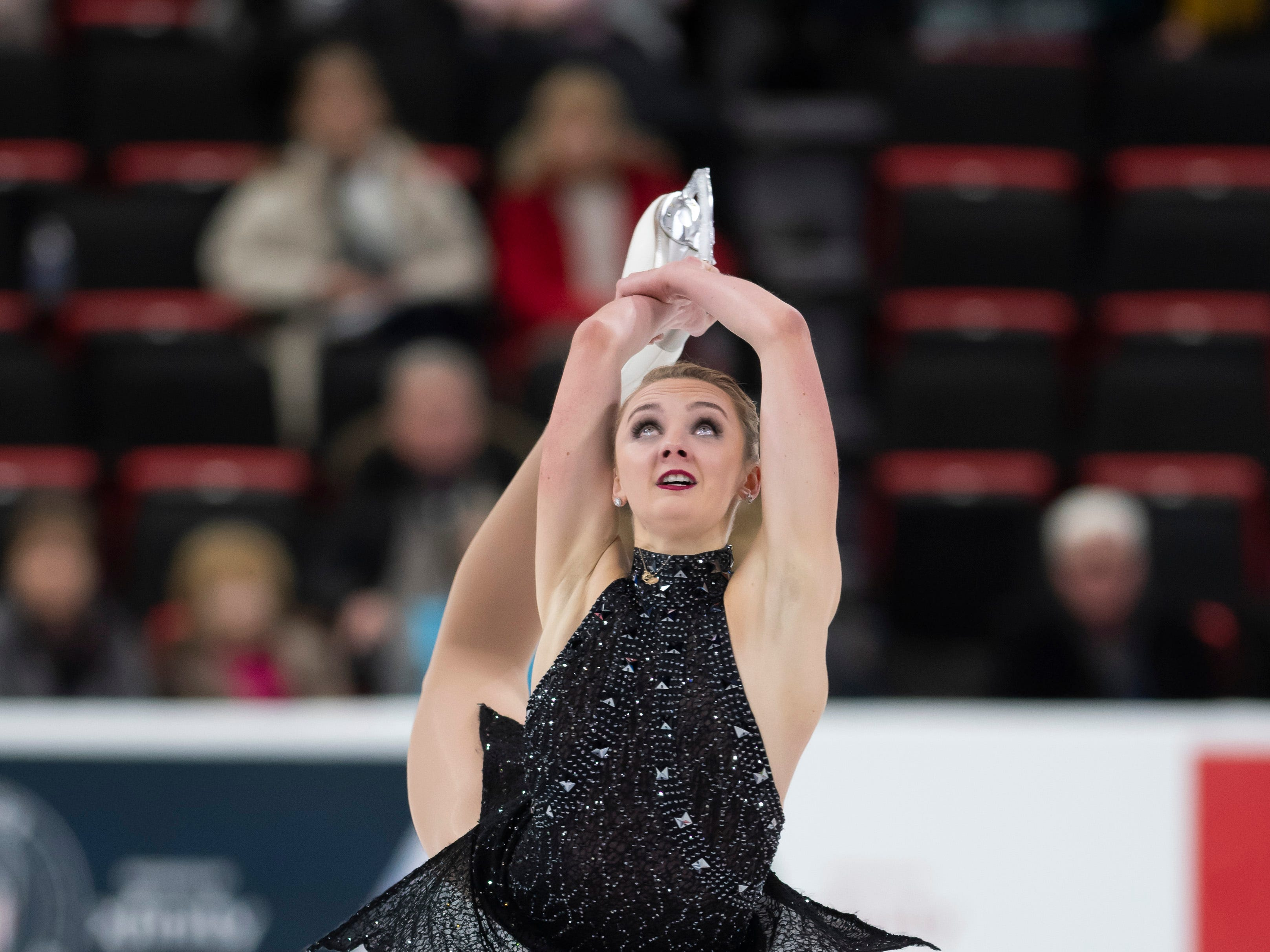 Heidi Munger competes in the ladies short program.