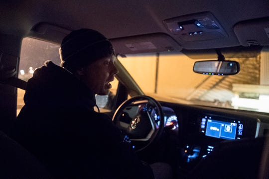 John Pritchett with the Aurora street team drives around Downtown Evansville looking at known spots for the homeless during Vanderburgh County's annual point-in-time count Wednesday, Jan. 23, 2019.