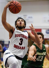 University of Southern Indiana's Mateo Rivera (3) drives past Missouri S & T's Nikola Andric (23) as the University of Southern Indiana Screaming Eagles play the Missouri Science & Technology Miners at the PAC Arena Thursday, January 24, 2019.