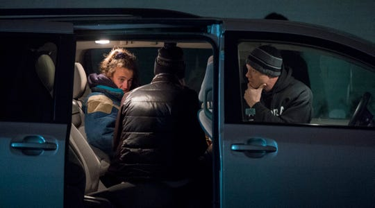 """Blanchie Wellman, left, answers questions for USI student Brianna Martin, middle, and Aurora street team member John Pritchett for Vanderburgh County's annual point-in-time count Wednesday, Jan. 23, 2019. She decided to not take advantage of the white flag at the shelter that night as temperatures dropped from 51 to 25 degrees. Wellman has been homeless for four years and said, """"I've survived it."""" She was given blankets and food."""