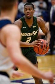 Missouri S & T's C.J. Hedgepeth (2) looks to pass as the University of Southern Indiana Screaming Eagles play the Missouri Science & Technology Miners at the PAC Arena Thursday, January 24, 2019.