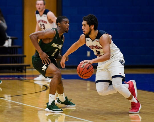 University of Southern Indiana's Mateo Rivera (3) drives against Missouri S & T's C.J. Hedgepeth (2) as the University of Southern Indiana Screaming Eagles play the Missouri Science & Technology Miners at the PAC Arena Thursday, January 24, 2019.