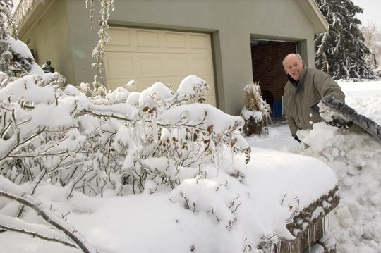 Dan Hartz, of Evansville, shovels his driveway after a plow cleared his street on Wednesday, January 28, 2009.  Hartz planned on working from home and hoped to spend a little time in his hot tub after shoveling.  Last night's storm left over 65,000 people without power and left many others struggling to dig out from under the ice and snow.