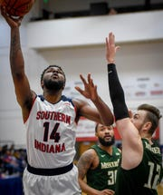 University of Southern Indiana's Emmanuel Little (14) shoots over Missouri S & T's Ervin Sarajlic (12) as the University of Southern Indiana Screaming Eagles play the Missouri Science & Technology Miners at the PAC Arena Thursday, January 24, 2019.