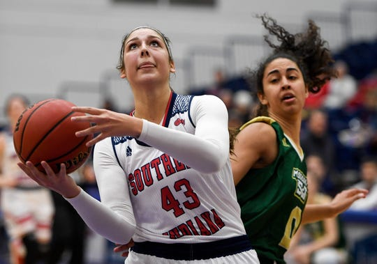 University of Southern Indiana's Kacy Eschweiler (43) drives past Missouri S & T's Mykala Baylor (0) as the University of Southern Indiana Women Screaming Eagles play the Missouri Science & Technology Miners at the PAC Arena Thursday, January 24, 2019.
