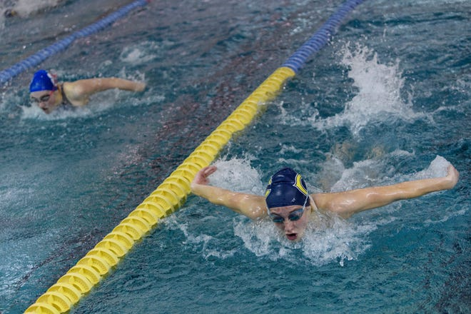 Castle's Kaitlyn Porter, right, edges out a win over Memorial's Lilia Newkirk, left, in the final 100-yard butterfly event during the SIAC swimming and diving championships at Castle High School in Newburgh, Ind., Saturday, Jan. 19, 2019.