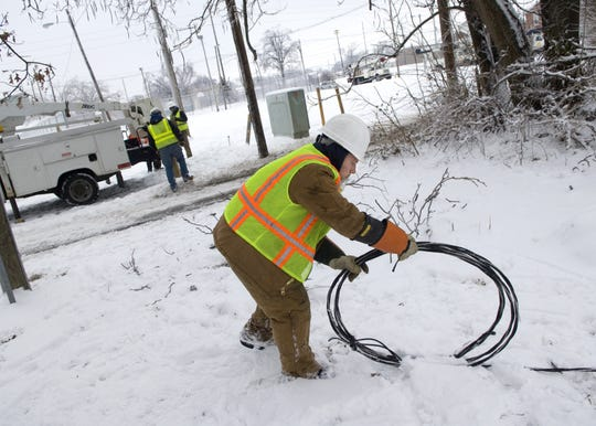 Tony Wright, an apprentice lineman for Campbell Electric Inc., of Indian River, Mi., takes care of a downed power line in downtown Evansville on January 29, 2009.  Many crews from out of state were on hand to help restore power to the area.