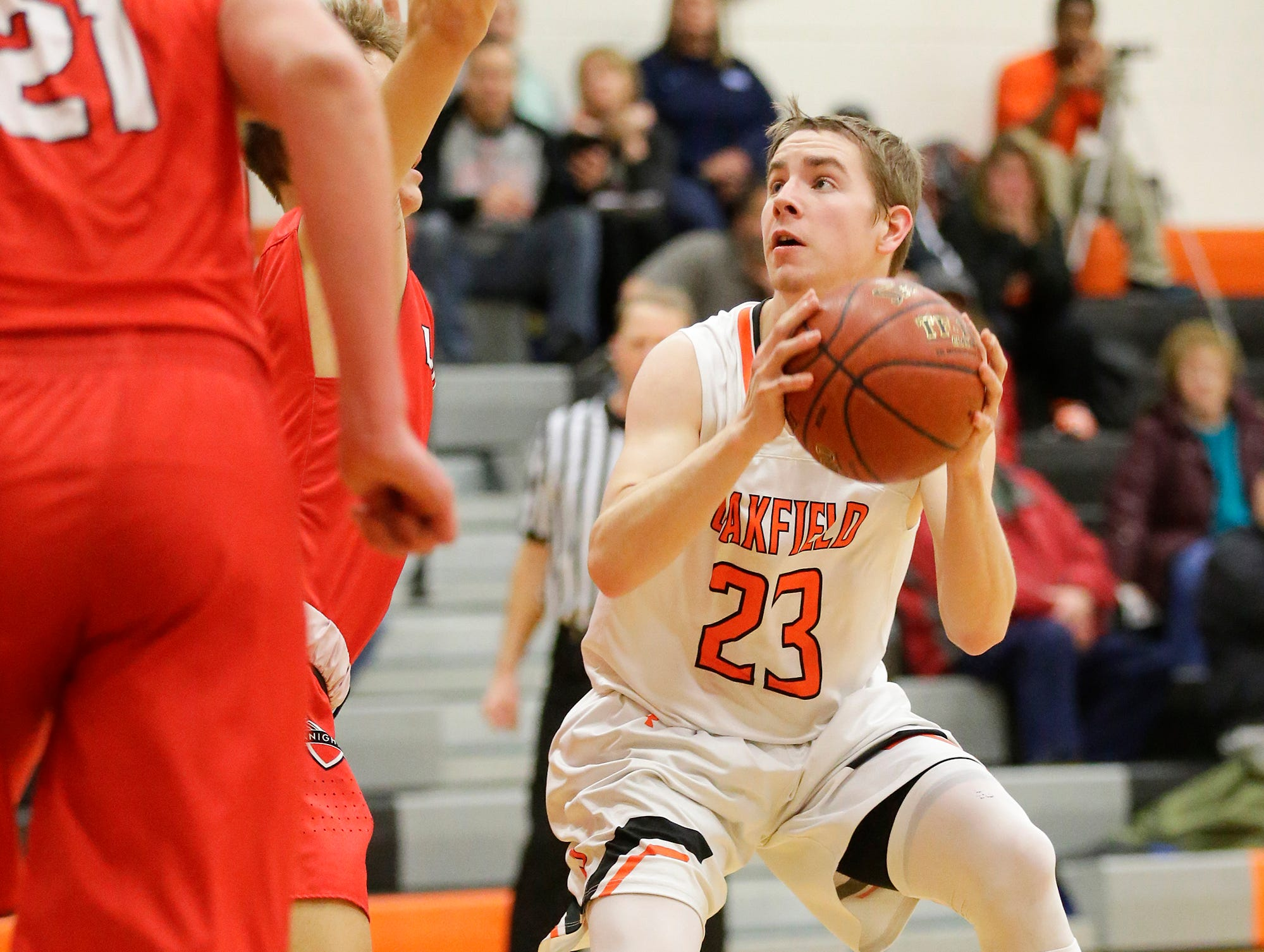 Oakfield High School boys basketball's Max Margelofsky eyes up the basket for a shot against Lourdes Academy of Oshkosh during their game Thursday, January 24, 2019 in Oakfield. Lourdes Academy won the game 83-48. Doug Raflik/USA TODAY NETWORK-Wisconsin