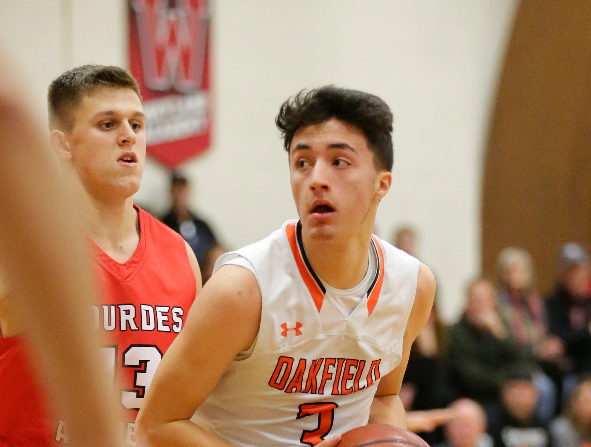 Oakfield High School boys basketball's Jacob Cedar looks for a player to pass to against Lourdes Academy of Oshkosh during their game Thursday, January 24, 2019 in Oakfield. Lourdes Academy won the game 83-48. Doug Raflik/USA TODAY NETWORK-Wisconsin