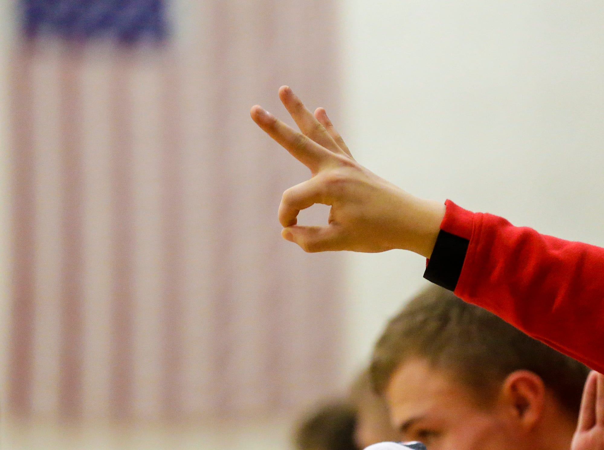A Lourdes Academy boys basketball player puts up three fingers after a player makes a three point basket against Oakfield High School during their game Thursday, January 24, 2019 in Oakfield. Lourdes Academy won the game 83-48. Doug Raflik/USA TODAY NETWORK-Wisconsin