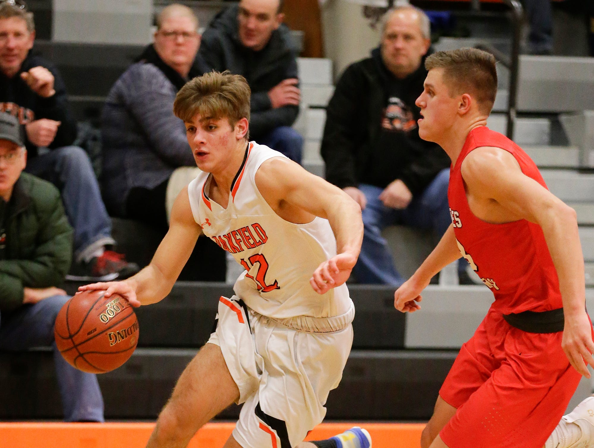 Oakfield High School boys basketball's Zach Seyfert works his way past Lourdes Academy's Caden Chier during their game Thursday, January 24, 2019 in Oakfield. Lourdes Academy won the game 83-48. Doug Raflik/USA TODAY NETWORK-Wisconsin