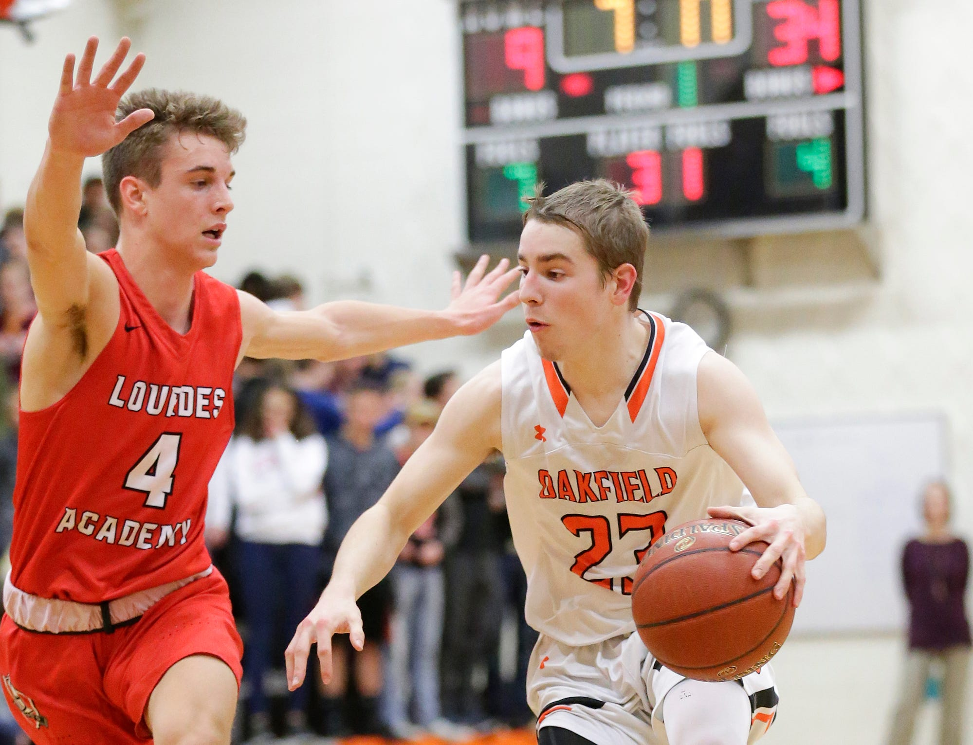 Oakfield High School boys basketball's Max Margelofsky drives in against Lourdes Academy's Preston Ruedinger during their game Thursday, January 24, 2019 in Oakfield. Lourdes Academy won the game 83-48. Doug Raflik/USA TODAY NETWORK-Wisconsin