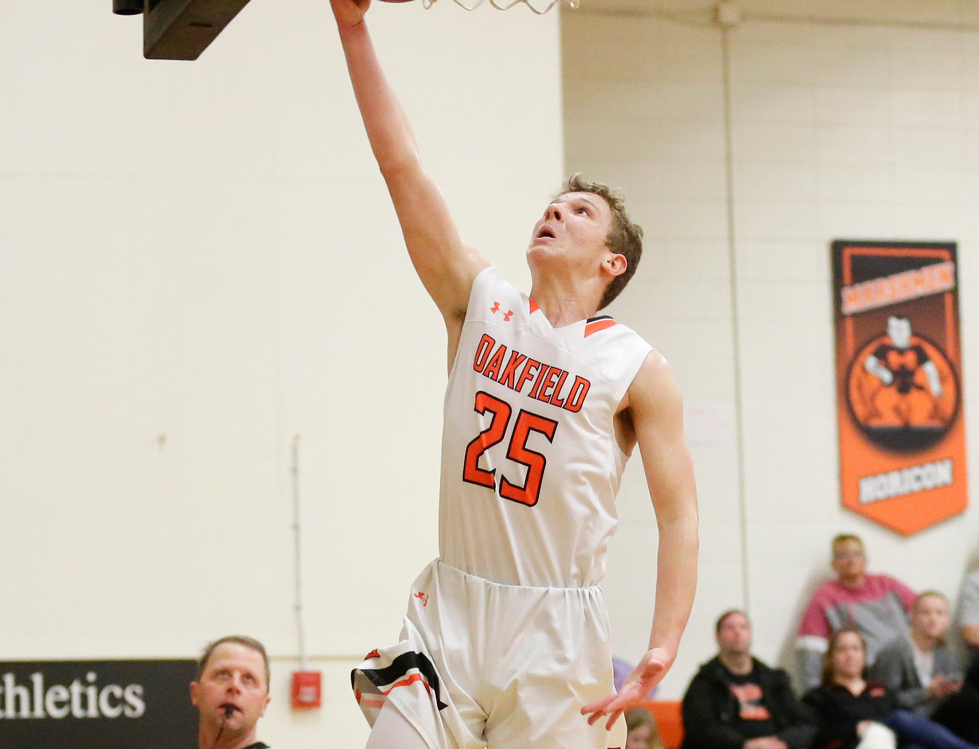 Oakfield High School boys basketball's Grant Bass goes up for a basket against Lourdes Academy of Oshkosh during their game Thursday, January 24, 2019 in Oakfield. Lourdes Academy won the game 83-48. Doug Raflik/USA TODAY NETWORK-Wisconsin