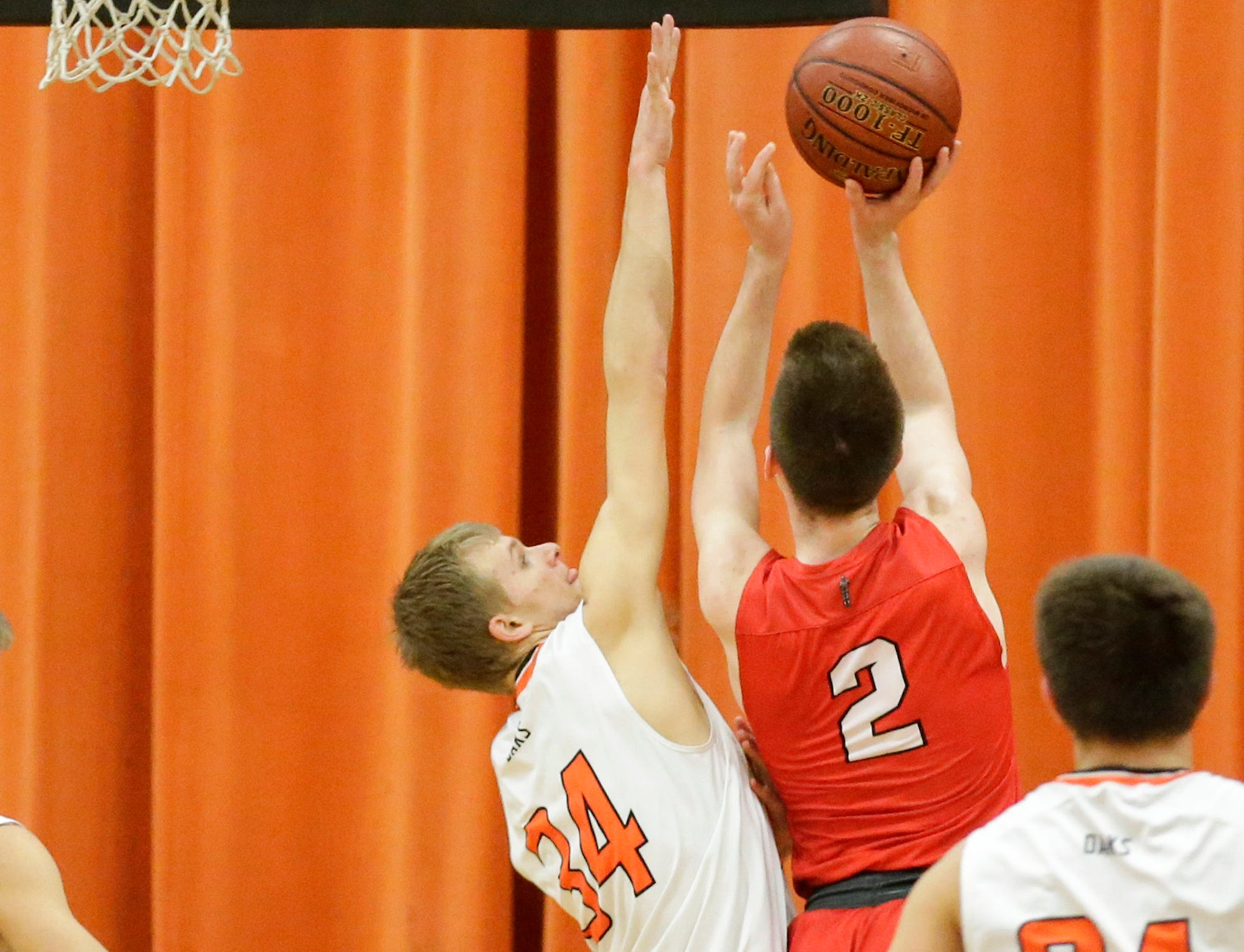 Oakfield High School boys basketball's Jaxson Hofman attempts to block a shot from Lourdes Academy's Henry Noone during their game Thursday, January 24, 2019 in Oakfield. Lourdes Academy won the game 83-48. Doug Raflik/USA TODAY NETWORK-Wisconsin