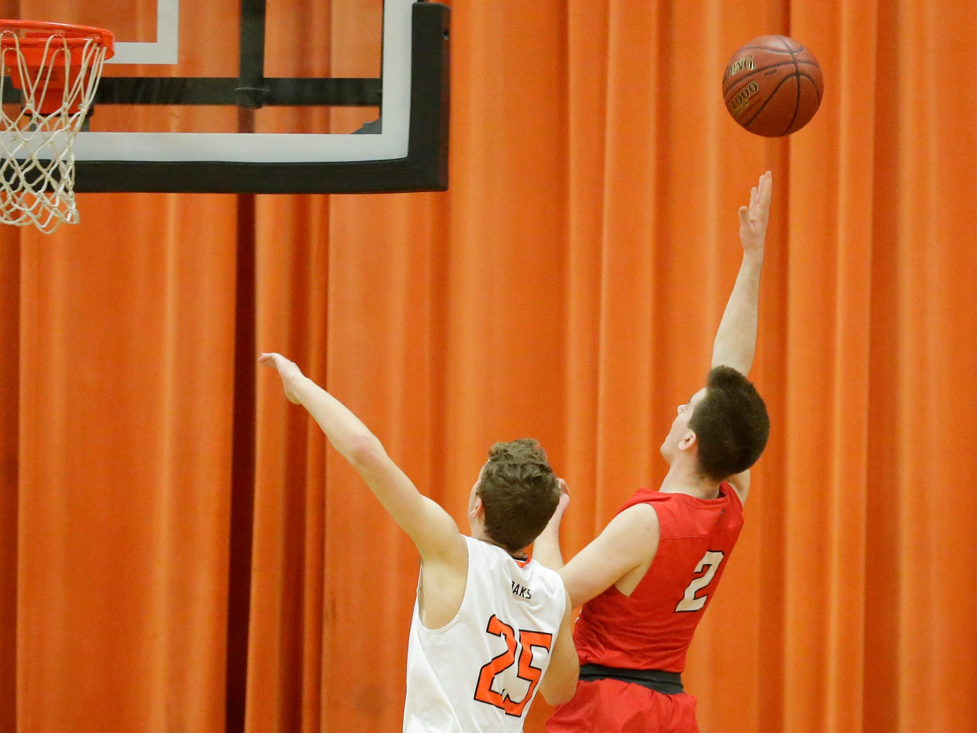 Oakfield High School boys basketball's Grant Bass fouls Lourdes Academy's Henry Noone during their game Thursday, January 24, 2019 in Oakfield. Lourdes Academy won the game 83-48. Doug Raflik/USA TODAY NETWORK-Wisconsin