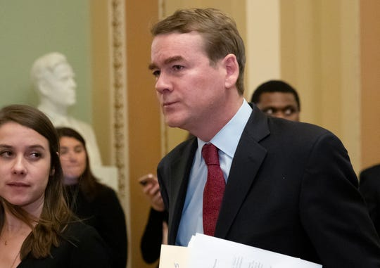 Sen. Michael Bennet, D-Colo., leaves the chamber after an emotional speech on the Senate floor over the partial government shutdown, at the Capitol in Washington, Thursday, Jan. 24, 2019. (AP Photo/J. Scott Applewhite)