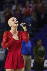 """You have to believe in yourself,"" says Dani Dease of singing the national anthem. Dease's stirring anthem performance at the opening of Florida SouthWestern State College's arena in 2016 was a highlight of the event."