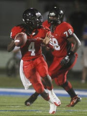 South Fort Myers' Dallas Crawford looks to throw against Barron Collier during a game in 2010.