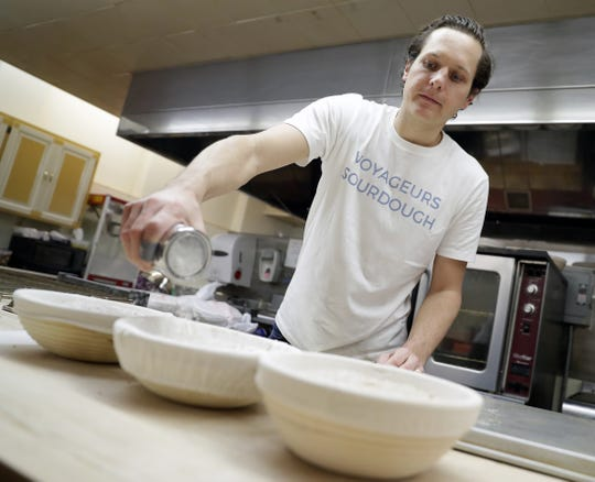 Ben Cadman of Voyageurs Sourdough prepares loaves of bread before putting them in the oven on Jan. 17, 2019, in Green Bay, Wis.