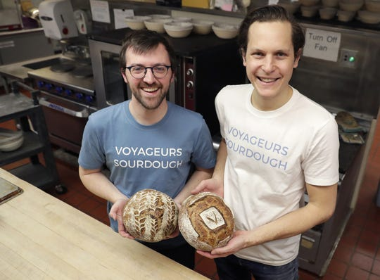 Kevin McGillivray, left, and Ben Cadman, co-owners of Voyageurs Sourdough,  in the kitchen at St. Jude Catholic Parish in Green Bay where they bake about 80 loaves of bread a day. Each Thursday, they deliver freshly baked bread to customers' doors.