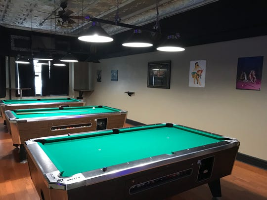 Rockabilly's Saloon owners Chris and Penny Knutson cleaned up the pool room and are adding vintage artwork to the walls.