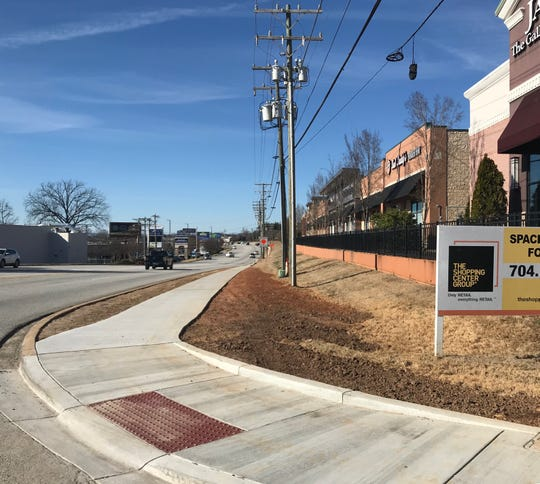 Newly constructed sidewalks line the north side of Woodruff Road in Greenville.