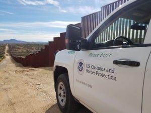 A truck waits to patrol the border along the U.S.-Mexico wall in Arizona.