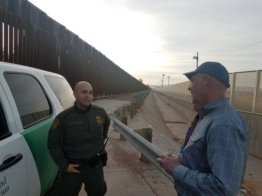 Rep. Greg Gianforte, R-Mont., talks with a border patrol worker in a tour of the U.S.-Mexico border in Arizona.