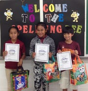 Capt. H.B. Price Elementary School's  top three spellers of the annual spelling bee held Jan. 14. From left: Third place Temi Willy in 5th grade winning word - peasantry; second place Alvina May in the 4th grade winning word - paramedic; first place Taga Blas in the 5th grade, winning word - fiddle faddle. Taga will represent the school in the regional spelling bee in March 2019.