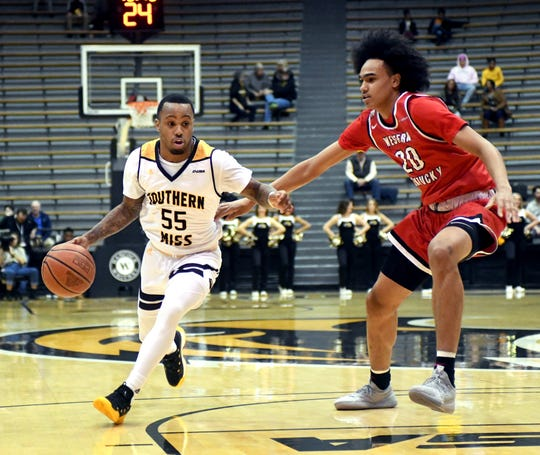 In this Jan. 24 file photo, Southern Miss guard Tyree Griffin takes control of the ball in a game against Western Kentucky in Hattiesburg. Southern Miss fell to WKU in the Conference USA Tournament semifinals Friday.