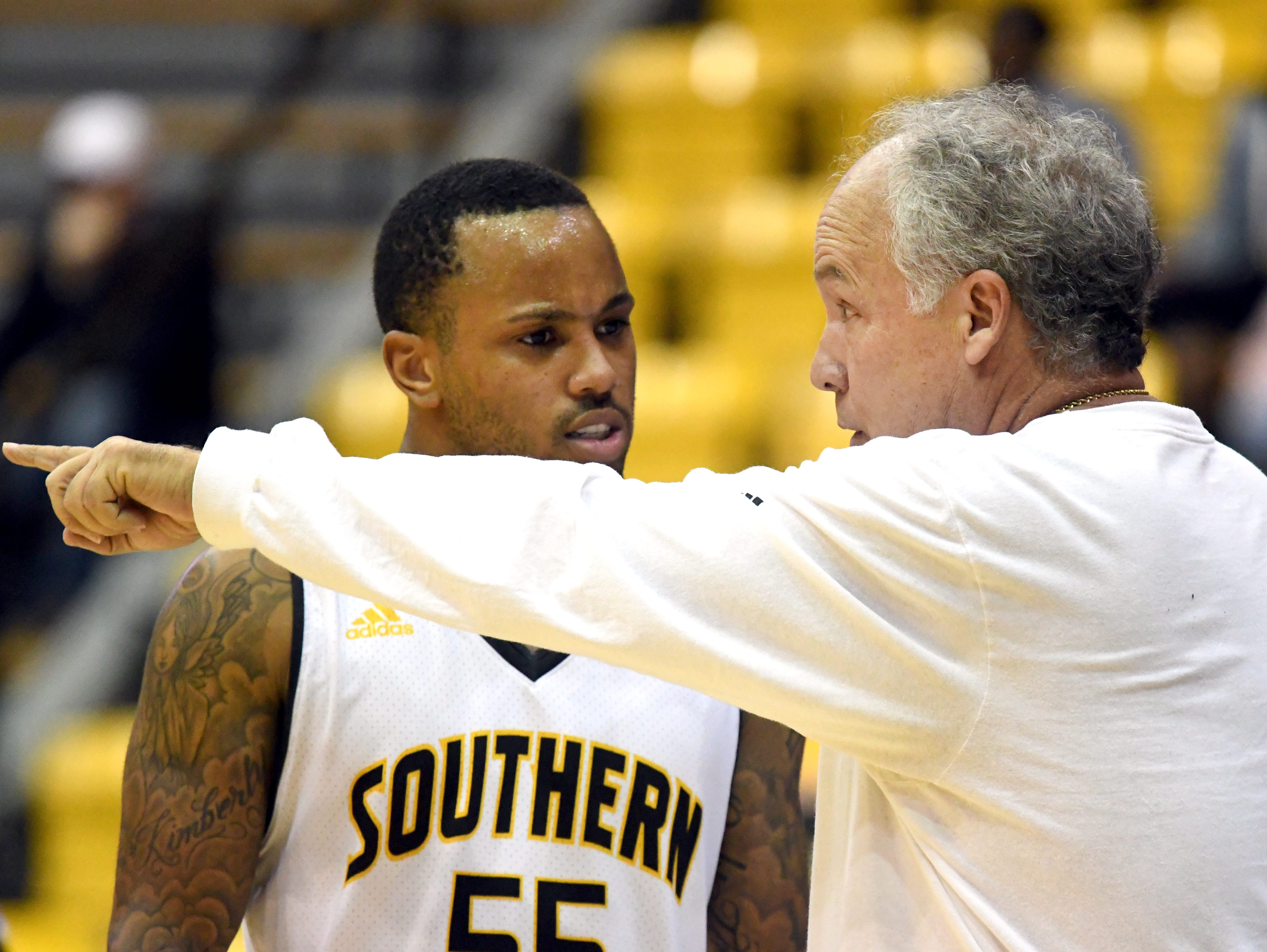 Southern Miss head coach Doc Sadler speaks with guard Tyree Griffin takes control of the ball in a game against Western Kentucky University in Reed Green Coliseum on Thursday, January 24, 2019.