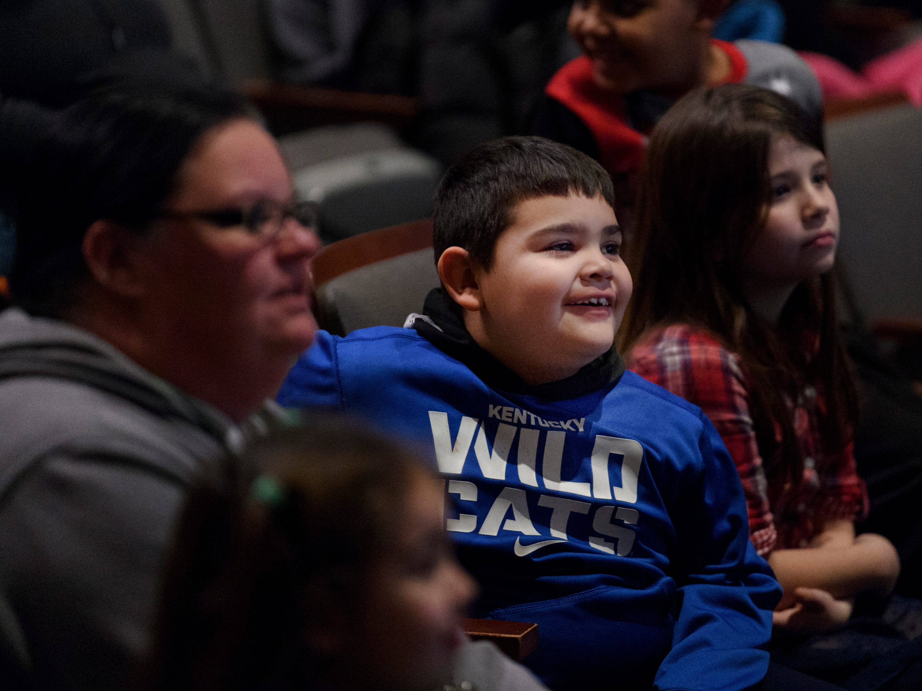 Marcos Gish, 7, watches a presentation about owls during a Family Night for Cairo and Jefferson elementary school students and their families at Henderson Community College's Preston Arts Center in Henderson, Ky., Thursday, Jan. 24, 2019. The event centered around a new National Geographic Photo Ark exhibit by photographer Joel Sartore, which will be on display for the public until March 15.