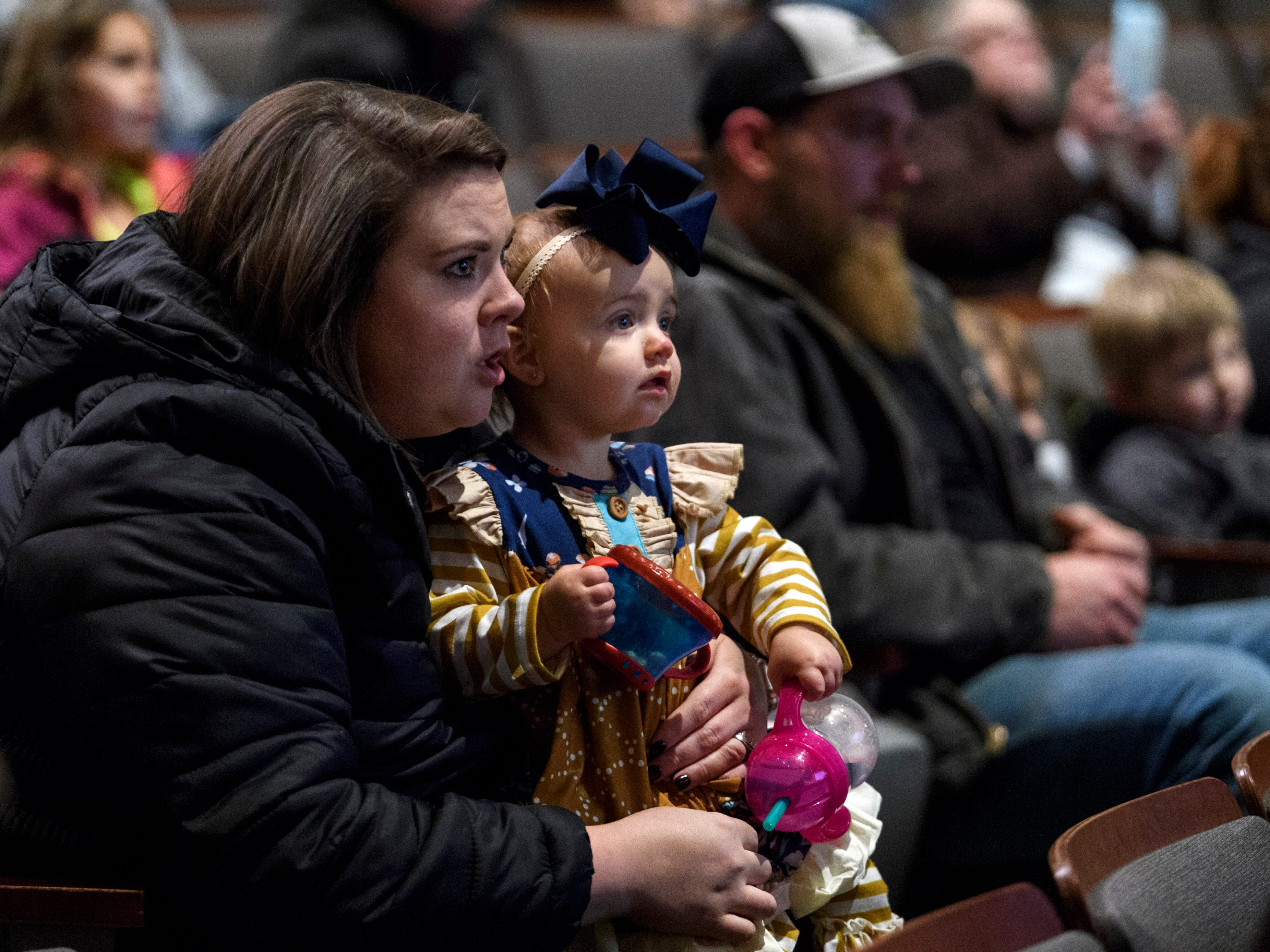Brylee Cannon and her one-year-old daughter Brynlie Cannon watch a presentation about owls during a Family Night for Cairo and Jefferson elementary school students and their families at Henderson Community College's Preston Arts Center in Henderson, Ky., Thursday, Jan. 24, 2019. The event centered around a new National Geographic Photo Ark exhibit by photographer Joel Sartore, which will be on display for the public until March 15