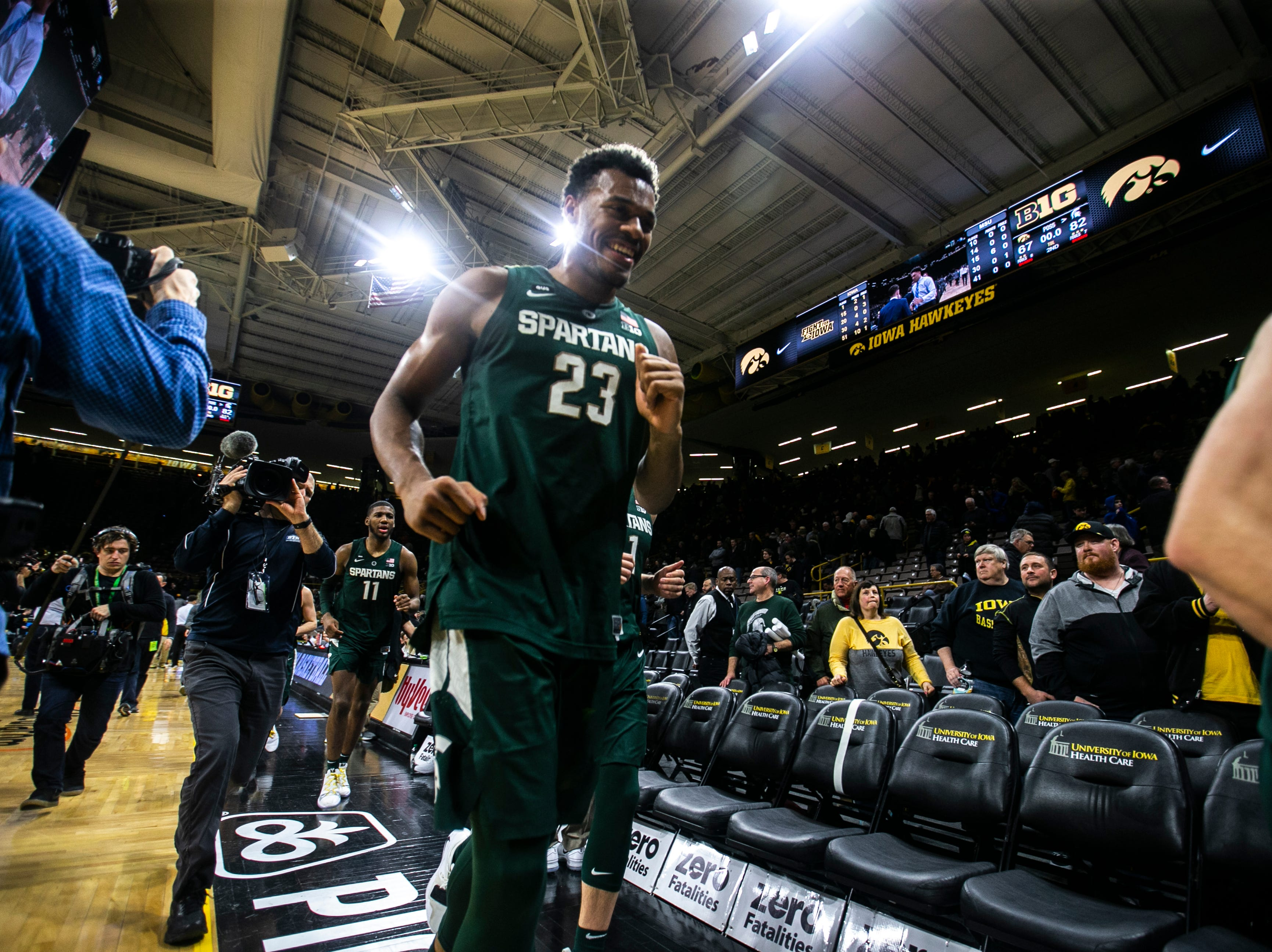 Michigan State forward Xavier Tillman (23) smiles while heading back towards the locker room during a NCAA Big Ten Conference men's basketball game on Thursday, Jan. 24, 2019, at Carver-Hawkeye Arena in Iowa City, Iowa.