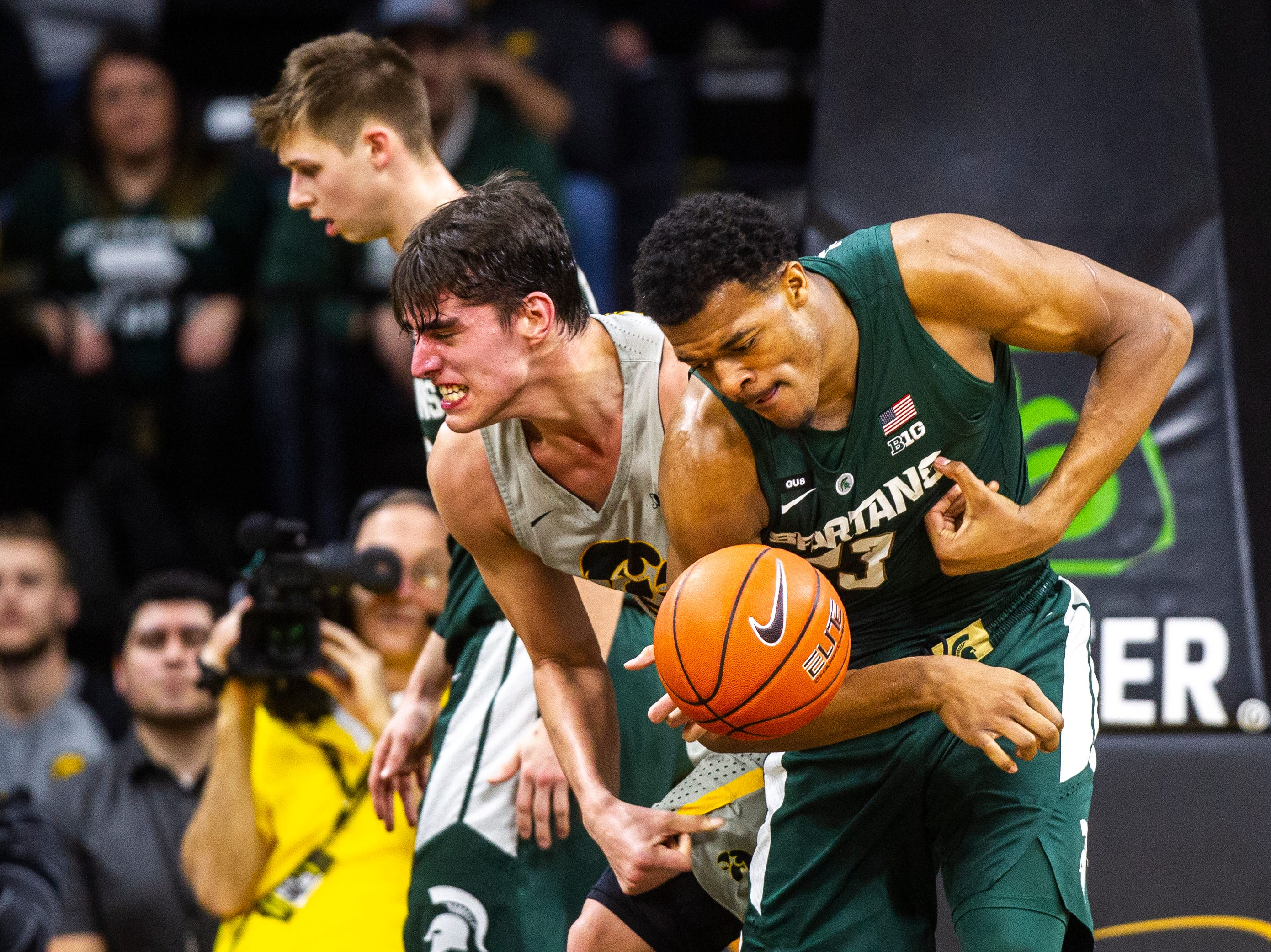 Iowa forward Luka Garza (55) and Michigan State forward Xavier Tillman (23) get tangled up while going for a rebound during a NCAA Big Ten Conference men's basketball game on Thursday, Jan. 24, 2019, at Carver-Hawkeye Arena in Iowa City, Iowa.