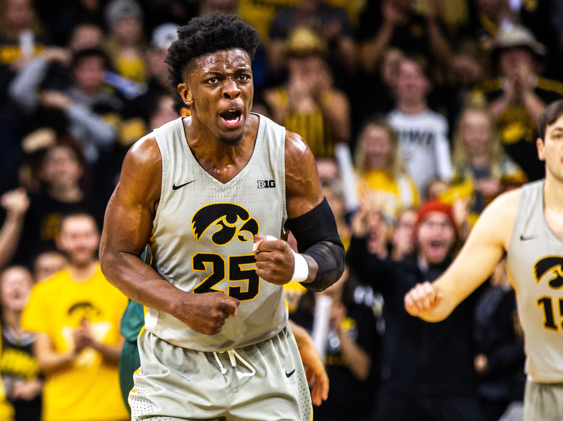 Iowa forward Tyler Cook (25) celebrates during a NCAA Big Ten Conference men's basketball game on Thursday, Jan. 24, 2019, at Carver-Hawkeye Arena in Iowa City, Iowa.