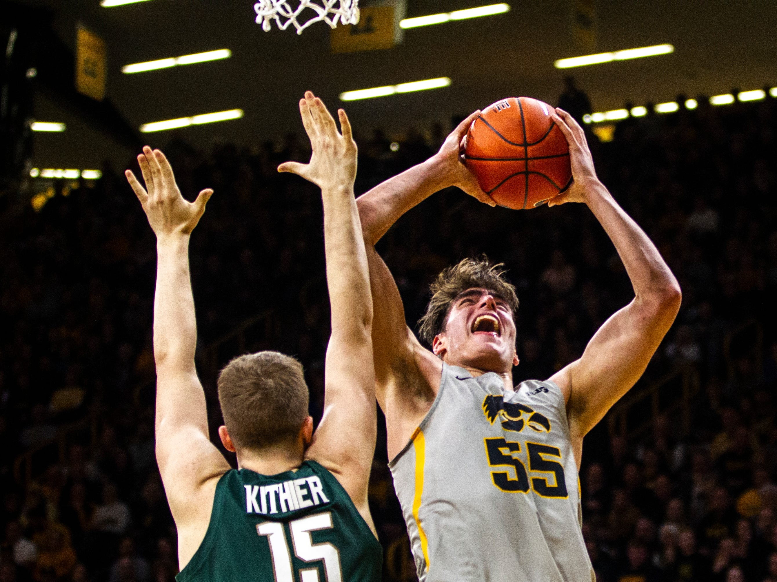 Iowa forward Luka Garza (55) drives to the basket during a NCAA Big Ten Conference men's basketball game on Thursday, Jan. 24, 2019, at Carver-Hawkeye Arena in Iowa City, Iowa.
